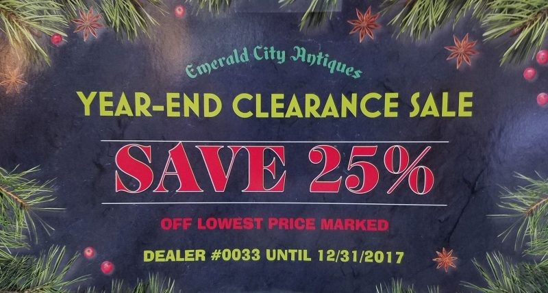 "a sale sign that reads ""Emerald City Antiques YEAR-END CLEARANCE SALE SAVE 25% OUR LOWEST PRICE MARKED DEALER #0033 UNTIL 12/31/2017"""