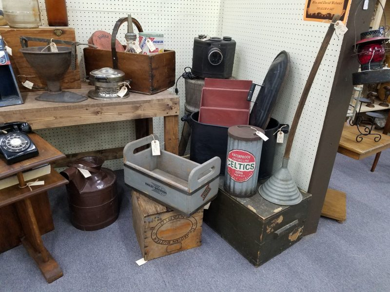 A photo of a booth filled with primitive-style items, mostly storage and decor