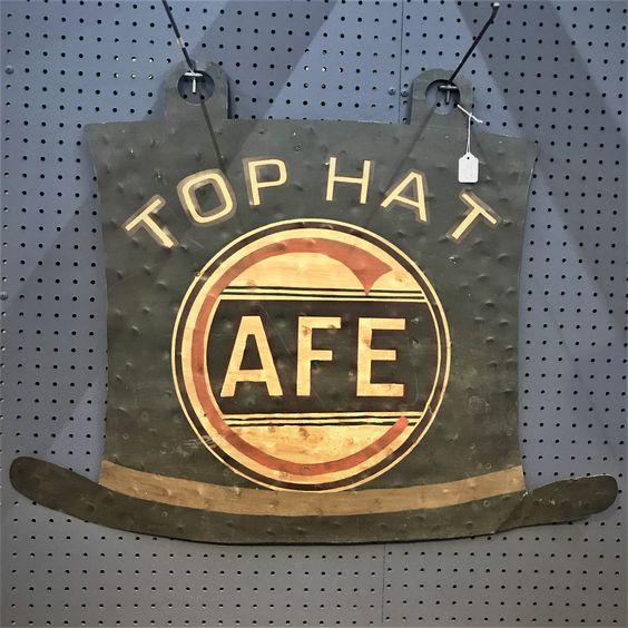 top hat cafe hanging sign