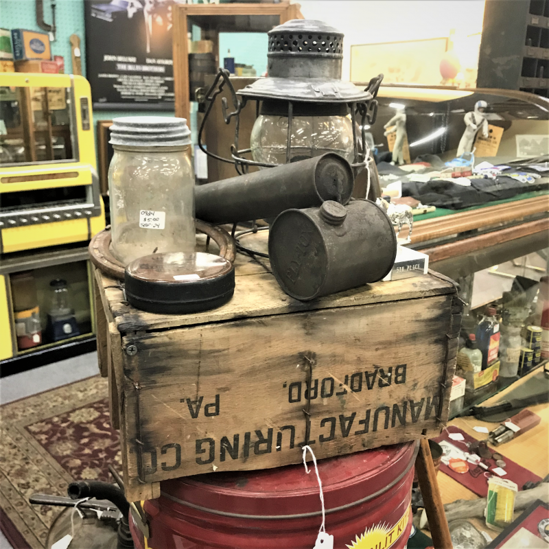 old wooden crate, old canning jar, and railroad lamp