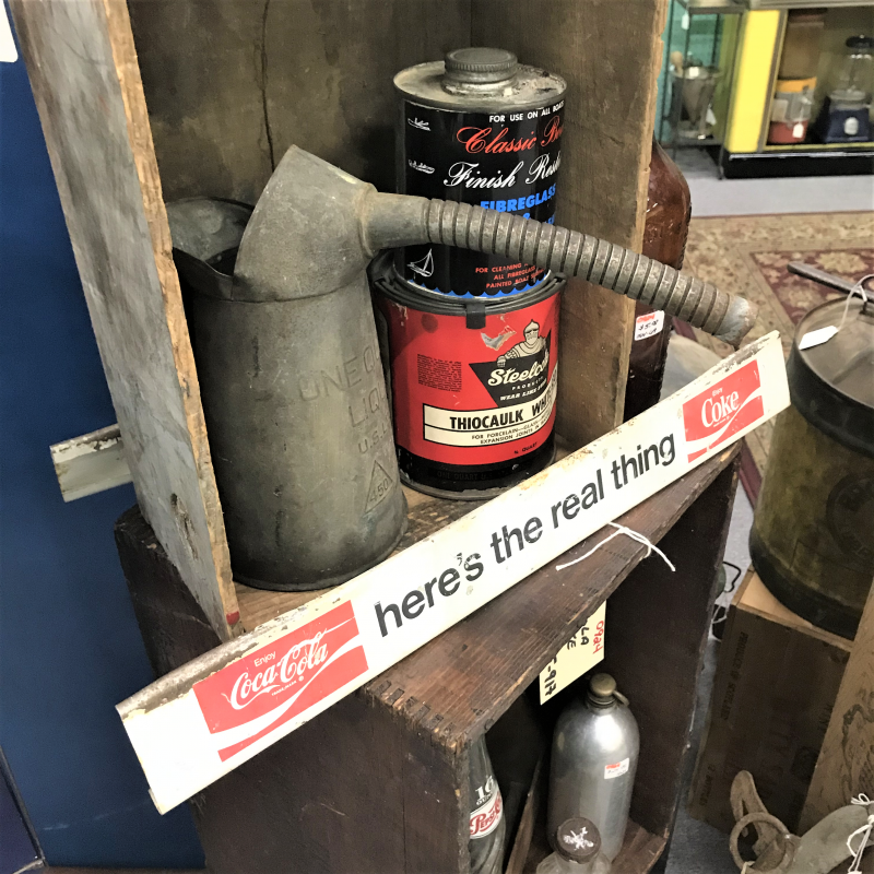 vintage coke sign, and rusty oil cans